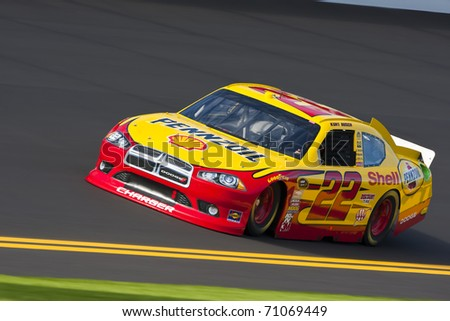 DAYTONA BEACH, FL - FEB 12, 2011:  Kurt Busch brings his Pennzoil Dodge out for a practice session for the Daytona 500 race at the Daytona International Speedway in Daytona Beach, FL on Feb 12, 2011. - stock photo