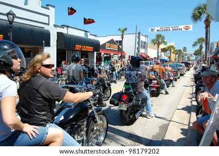 "DAYTONA BEACH, FL - MARCH 17:  Bikers cruise Main Street during ""Bike Week 2012"" in Daytona Beach, Florida.  March 17, 2012"