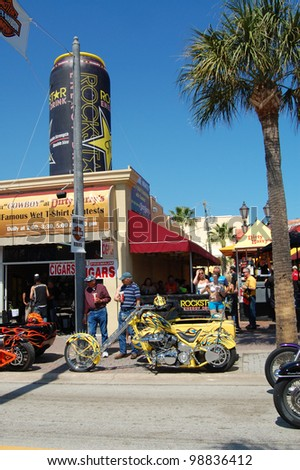"DAYTONA BEACH, FL - MARCH 17:  Customized motorcycles line Main Street during ""Bike Week 2012"" in Daytona Beach, Florida."