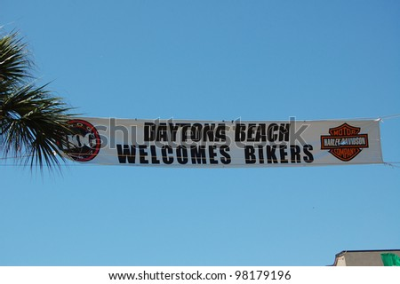 "DAYTONA BEACH, FL - MARCH 17:  Welcome banners hang across Main Street amid the sea of bikers in town for ""Bike Week 2012"" in Daytona Beach, Florida. March 17, 2012"