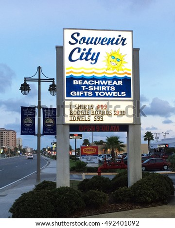 DAYTONA BEACH SHORES,FL-SEPTEMBER 30, 2016:  Illuminated sign for a local souvenir or gift shop in Daytona Beach shores, FL.  Image was taken at dusk.