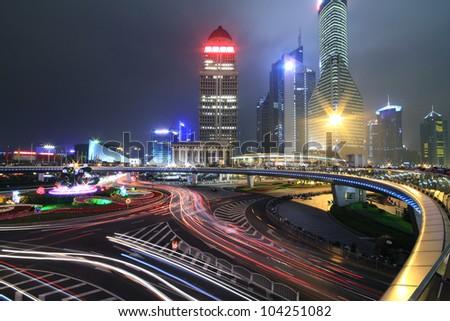 Dazzling rainbow overpass ring highway night scene in Shanghai Lujiazui - stock photo