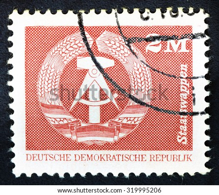 """DDR - CIRCA 1975: A Stamp printed in GDR (German Democratic Republic - East Germany) shows DDR national coat of arms, series """"GDRs national coat of arms"""", circa 1975 - stock photo"""