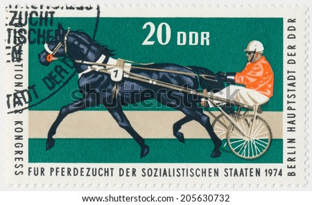 DDR - CIRCA 1974: A stamp printed in Germany shows horse racing and Jockey, circa1974