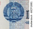 DDR symbol on a 100 Mark banknote from East Germany  - Note: no more in use since german reunification in 1989 - stock photo
