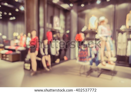 De focused background Sports fashion clothing store in Inter Sport store,interior with showcases and shelves in a department store with bokeh, city shopping mall lights ,vintage color with copyspace - stock photo