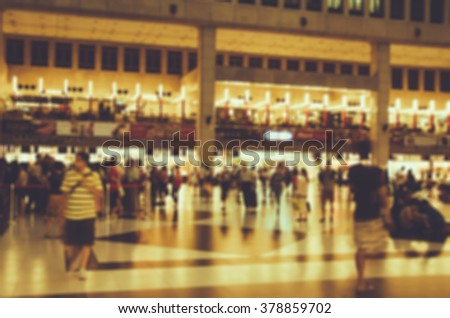 De focused/Blur image of crowd in train station hall. People waiting in line to buy train tickets. Restaurants on second floor. Train station background. Polaroid effect. - stock photo