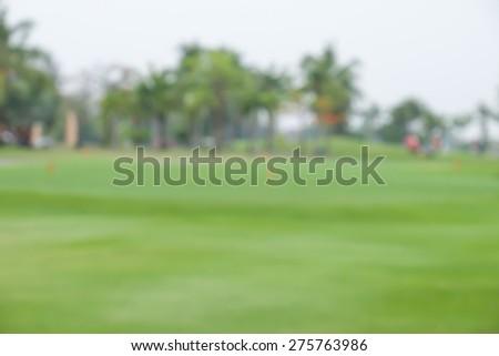 De focused or blurred golf green field for landmark background - stock photo