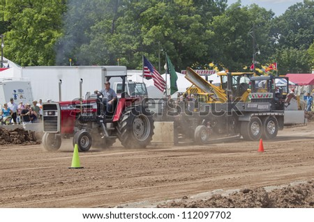 DE PERE, WI - AUGUST 18: A tractor preparing the Attitude Adjuster weight at the Tractor Pull event at the Brown County Fair on August 18, 2012 in De Pere, Wisconsin.