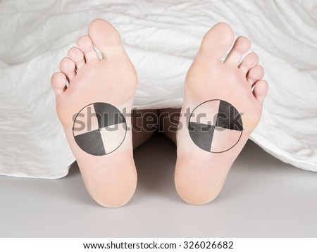 Dead body under a white sheet, suicide, murder or natural death - stock photo