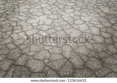 Dead desert with detail of cracked earth - stock photo