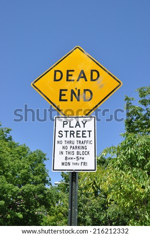 Dead End Play Street No Thru Traffic clear blue sky Trees