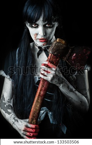 Dead female zombie with bloody axe. Halloween concept - stock photo