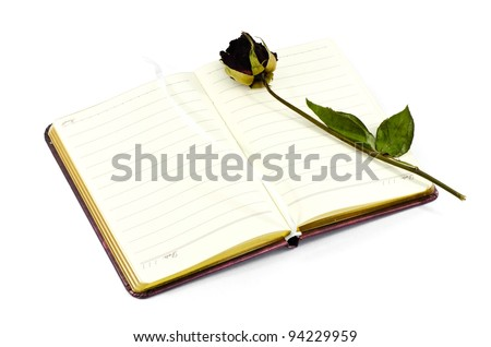 Dead roses put on the note book. - stock photo