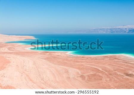 Dead Sea coastline in desert uninhabited extraterrestrial landscape aerial view - stock photo