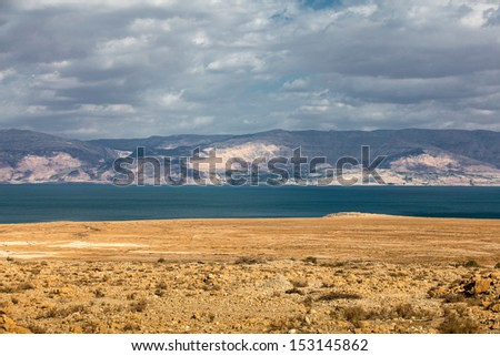 Dead Sea in the desert with mountain view - stock photo