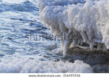 Dead Sea Salt structure reaching edge of the water - stock photo
