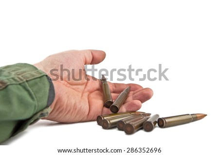 dead soldier from whose hands spilled cartridges - stock photo