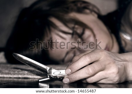 dead woman lying on the floor telephone in the hand - stock photo
