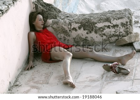 dead woman lying on the ground - stock photo