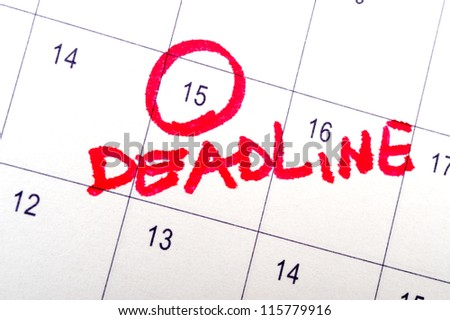 Deadline word written on the calendar - stock photo