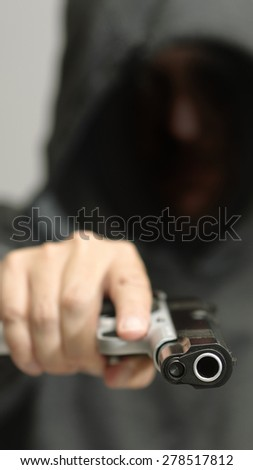 Deadly Gangster with a Pointed Gun - stock photo