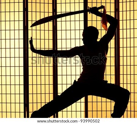deadly japanese assassin wields sword and focuses on his next victim - stock photo