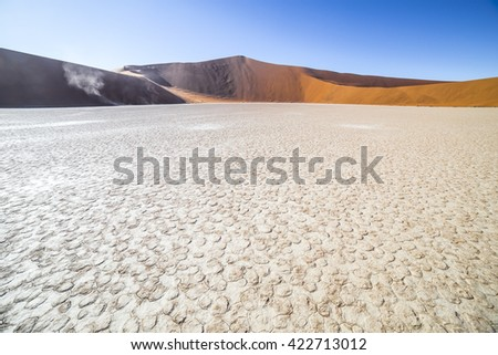 Deadvlei, or Dead Vlei, a white clay pan located near the more famous salt pan of Sossusvlei, inside the Namib-Naukluft Park in Namibia - stock photo