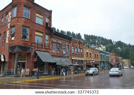 Deadwood, USA - August 18, 2015: view of the Historic Main Street in Deadwood, South Dakota, USA. The city is famous for the murder of Wild Bill Hickok and its wild west past.  - stock photo