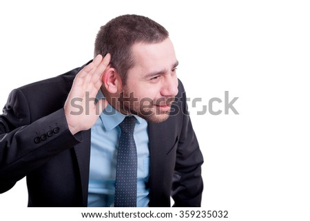 Deaf businessman trying to listen - stock photo