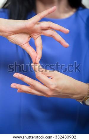 Deaf woman using sign language, close up - stock photo
