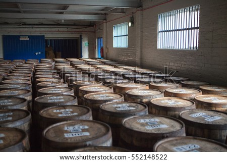 Deanston Distillery, Doune, UK - 23 April, 2015: Barrels for whiskey stacked in the cellar.