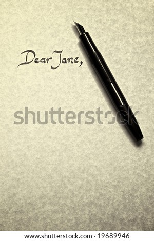 dear jane letter being written in calligraphy on parchment paper with pen