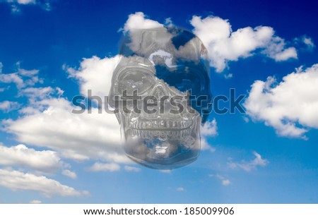 Death from the skies. Human skull against the sky - stock photo