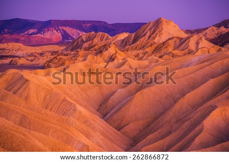 Death Valley Badlands Formation at Dusk. Death Valley National Park, California, USA. - stock photo