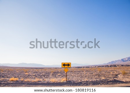 Death Valley, California. Direction sign in the middle of the desert. - stock photo