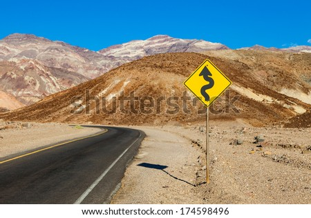 Death Valley, California. Road in the middle of the desert - stock photo