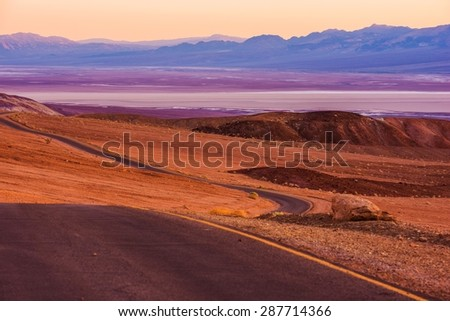 Death Valley Raw Scenery at Dusk. Valley Road. California, United States.