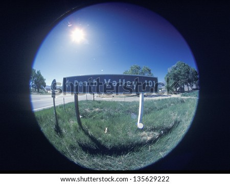 Death Valley 101 sign taken with a circular fisheye lens - stock photo