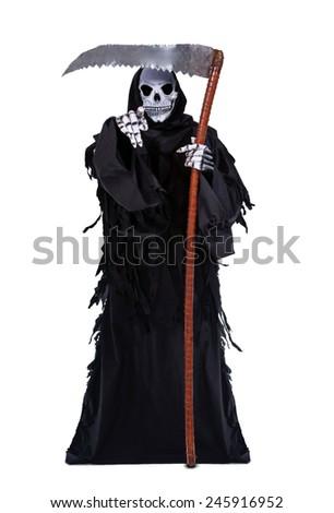 Death with a scythe shows forward - stock photo