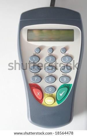 Debit card pinpad terminal on white background - stock photo