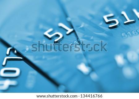 Debit cards in blue tone. Macro shot. Selective focus. - stock photo