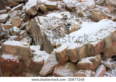 Debris of a destroyed building under the snow - stock photo