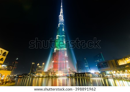 DEC 03 -DUBAI, UAE:  Burj Khalifa Tower is illuminated  in the white, green and red colours of the flag of the UAE to celebrate the 42nd National Day. on the third of december,2013 in Dubai,UAE. - stock photo