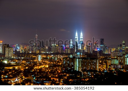 DEC 05, 2015 - Kuala Lumpur, Malaysia: The night panorama in Kuala Lumpur City. Long exposure caused the motion effect on the sky.