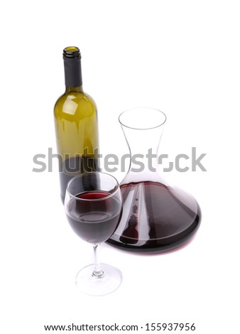 Decanter, bottle and glass with red wine. Isolated on a white background. - stock photo