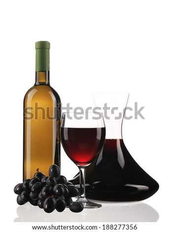 Decanter bottle and glass with red wine. Isolated on a white background. - stock photo