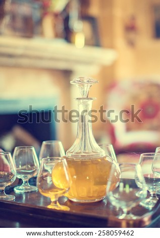 Decanter with glasses on the table. - stock photo