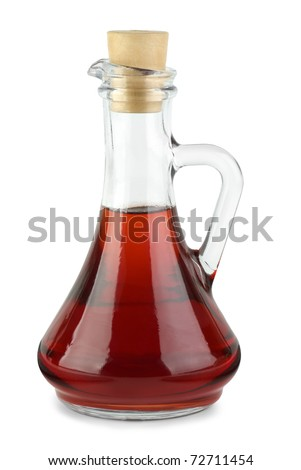 Decanter with red wine vinegar  isolated on the white background - stock photo