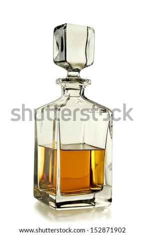 decanter with whiskey on white background - stock photo